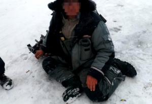Спасатели сняли неадекватного рыбака со льда у Бугринского моста